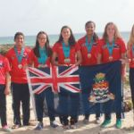 Cayman's swim team brings home 13 medals