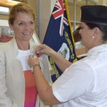 Governor pinned with first poppy