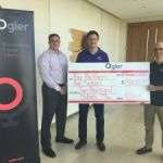 Law firm donates to mentoring charity