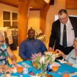 Ezzard Miller hosts dinner for seniors