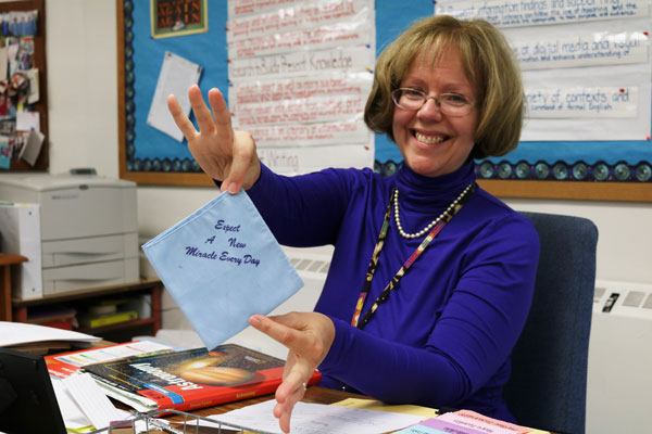 Liz Gilbert, the middle school teacher at Swan Meadow School in Oakland, Md., poses with one of her desk accessories on Wednesday, October 5, 2016. Gilbert has taught at the school for 25 years. (Vickie Connor/Capital News Service)