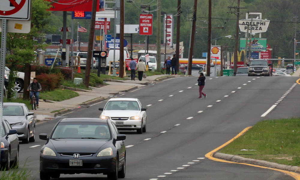 University wasn't designed for the walking community that lives there now, officials say. There are long gaps between crosswalks in what has become a densely populated enclave of immigrants, including many new arrivals unfamiliar with U.S. traffic laws. (Capital News Service photo by Michelle Sloan)
