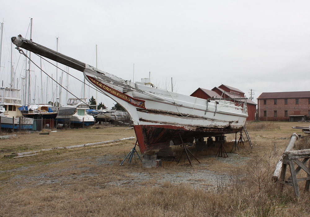 An old boat awaits its fate in Cambridge, Md. According to Robert T. Brown, president of the Maryland Waterman's Association, the average age of a waterman is somewhere in the 60s. (Photo by J.F. Meils/Capital News Service)
