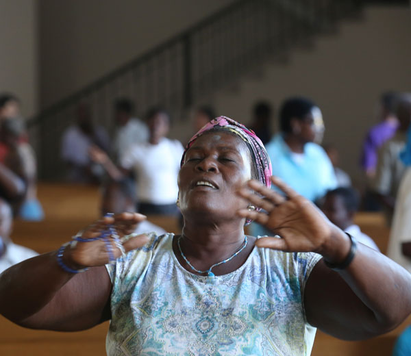 Marie Yolene Andre prays during Mass on Ash Wednesday, Feb. 18, at the archdiocese's transitional cathedral in Port-au-Prince. (CNS/Bob Roller)