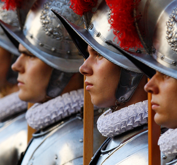 Swiss Guard recruits stand at attention during a swearing-in ceremony at the Vatican. (CNS/Paul Haring)