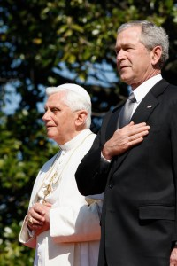 Pope Benedict XVI was the last pontiff to visit the White House, shown here with President George W. Bush during the playing of the national anthem on the South Lawn of the White House April 16, 2008. (CNS/Nancy Wiechec)