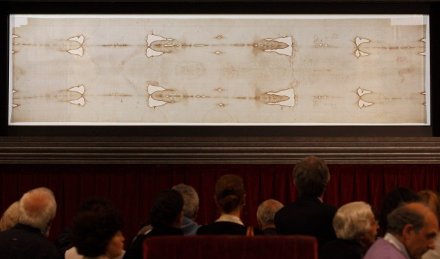 People view the Shroud of Turin on display at the Cathedral of St. John the Baptist in Turin, Italy, in 2010. (CNS/Paul Haring