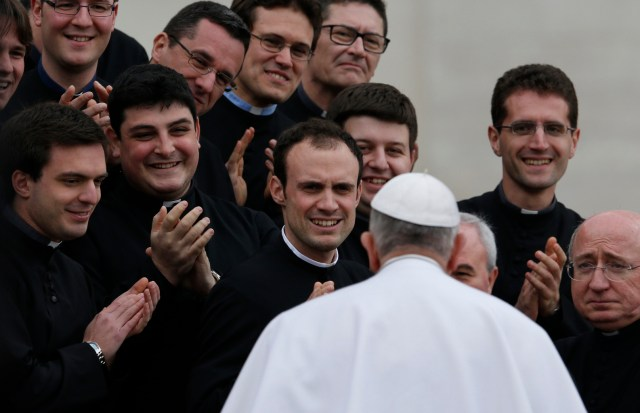 Pope Francis greets clergy during his general audience March 4. (CNS/Paul Haring)