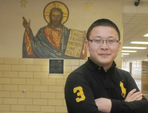 Peter Yang, 18, a senior at Cathedral High School in St. Cloud, Minn., is going through the Rite of Christian Initiation of Adults to become a Catholic at the Easter Vigil. (CNS/Dianne Towalski, The Catholic Spirit)