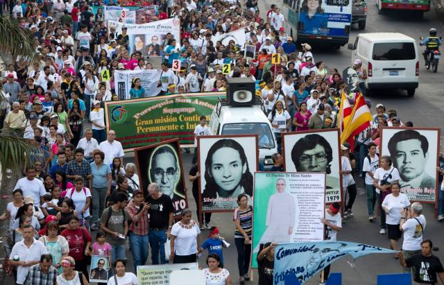 People carry banners of Archbishop Oscar Romero and other martyrs March 21 in San Salvador, El Salvador, to mark the 35th anniversary of Archbishop Romero's death. (CNS/Octavio Duran)