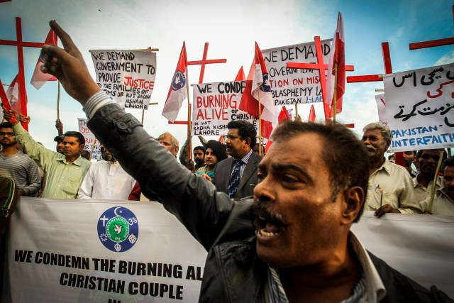 Pakistanis protest after a Christian couple was burned alive for alleged blasphemy in November. (CNS/EPA)