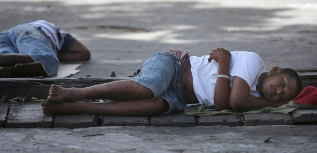 Men sleep on a sidewalk in Georgetown, Guyana, March 14. The World Bank and global faith leaders are joining together to end extreme poverty around the world by 2030. (CNS/Bob Roller)