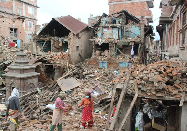 Earthquake survivors of Harsiddhi village on the outskirts of Kathmandu, Nepal, retrieve belongings from their destroyed homes April 29, five days after a major earthquake struck the region. (CNS/Anto Akkara)