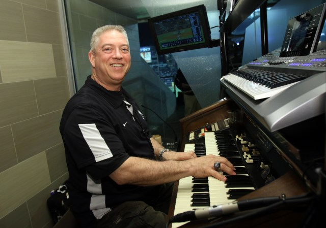 New York Yankees organist Paul Cartier poses for a photo during a Major League Baseball game between the Yankees and the Toronto Blue Jays at Yankee Stadium in the Bronx, N.Y., April 8. Cartier is also an organist for the National Hockey League's New York Islanders and at Our Lady of Hope Parish in Carle Place, N.Y. (CNS photo/Gregory A. Shemitz)