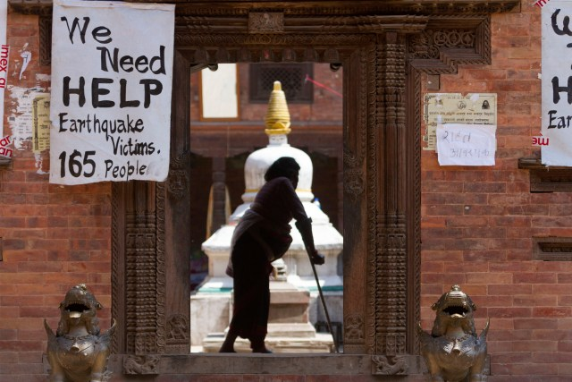A sign, written by earthquake survivors, asks for help and hangs on the wall of their temporary shelter in Bhaktapur, Nepal, May 2. (CNS/EPA)