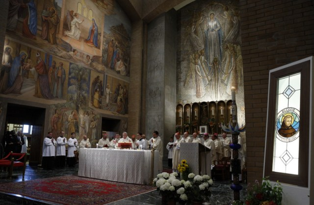 "An image of Blessed Junipero Serra, right, is seen as Pope Francis celebrates Mass at the Pontifical North American College in Rome May 2. It was the first papal visit to the U.S. seminary since 1980. At the end of Mass, Pope Francis said the visit to the seminary was ""a beautiful and meaningful introduction to my apostolic visit to the United States of America."" (CNS photo/Paul Haring) See POPE-NAC and SERRA-NAC May 2, 2015."