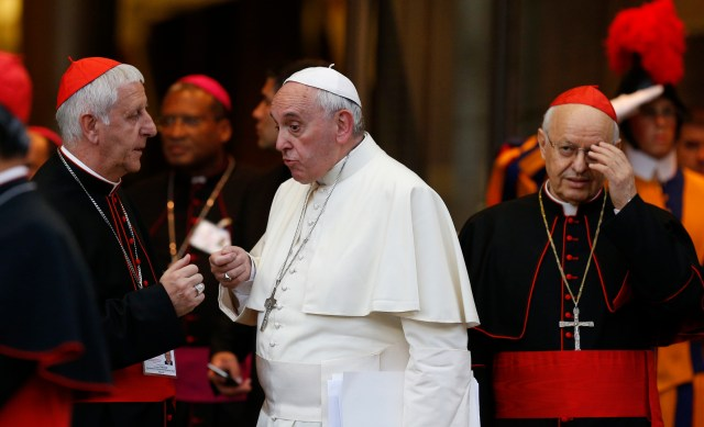 Pope Francis talks with Italian Cardinal Giuseppe Versaldi as they leave the concluding session of the extraordinary Synod of Bishops on the family at the Vatican last year. At right is Italian Cardinal Lorenzo Baldisseri, general secretary of the Synod of Bishops. (CNS/Paul Haring)