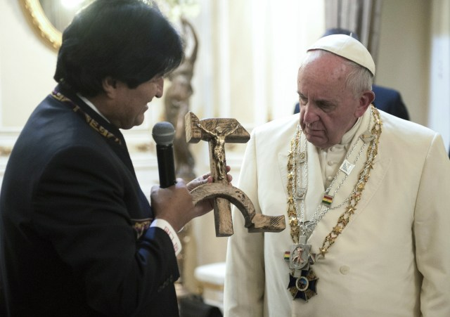 Bolivian President Evo Morales presents a gift of a wooden hammer and sickle with a figure of a crucified Christ to Pope Francis at the government palace in La Paz July 8. (CNS/L'Osservatore Romano)