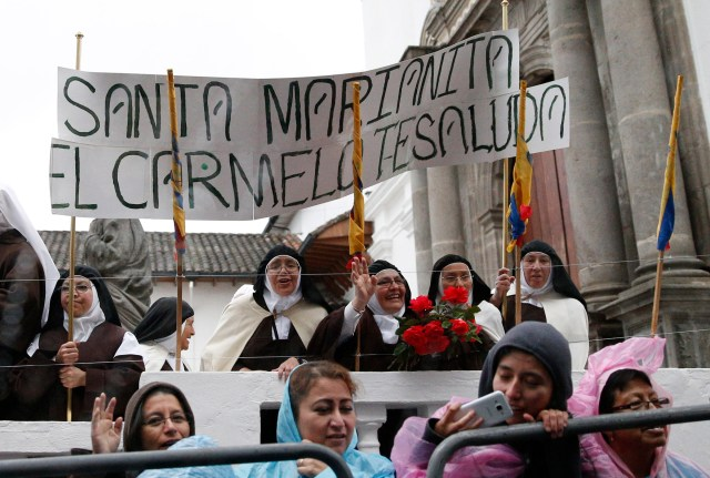 Carmelite nuns wait for a glimpse of Pope Francis as he arrives for a meeting with representatives of civil society in the Church of St. Francis in Quito July 7. (CNS/Paul Haring)