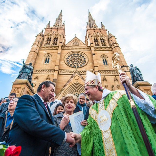 Archbishop Anthony Fisher of Sydney congratulates a couple on the renewal of their wedding vows outside St. Mary's Cathedral July 12. (CNS/Giovanni Portelli, The Catholic Weekly)