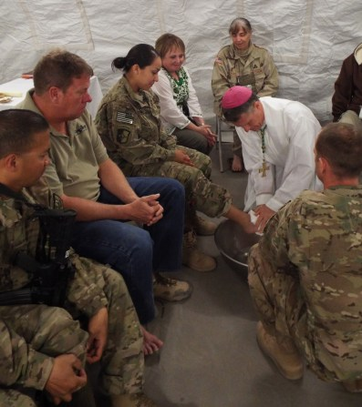 Archbishop Timothy P. Broglio, of the U.S. Archdiocese for the Military Services, washes the feet of a U.S. soldier in 2014 on Holy Thursday in Afghanistan at Shindand Air Base, located in Herat province. (CNS/courtesy of the Archdiocese for the U.S. Military Services)