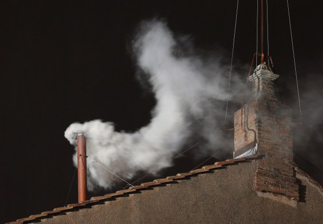 White smoke billows from the chimney of the Sistine Chapel March 13, 2013, at the Vatican. Argentine Cardinal Jorge Mario Bergoglio, now Pope Francis, was elected the 266th Roman Catholic pontiff. Details surrounding the pope's election and other events can be found in the Vatican's recently published annual report of activities in 2013. (CNS/Paul Haring)