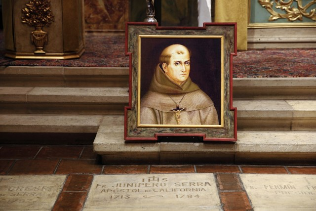 A portrait of Blessed Junipero Serra sits above his tomb in San Carlos Borromeo de Carmelo Mission in Carmel, Calif. His body rests between those of companion missionary Father Juan Crespi and the California missions' second president, Father Fermin Lasuen. (CNS/Nancy Wiechec)
