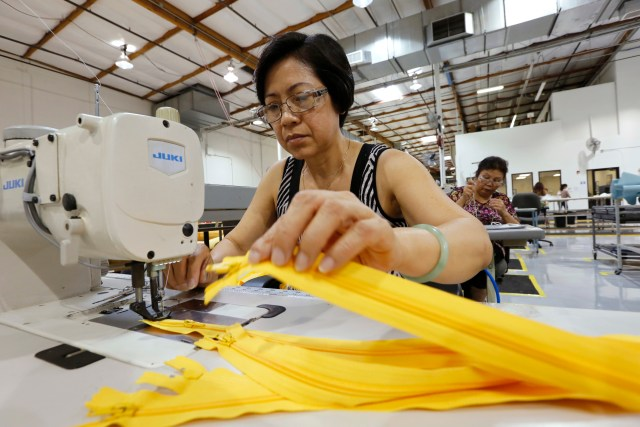 Women work in the sewing area at a manufacturer of aircraft emergency evacuation slides last year. Labor Day, honoring U.S. workers, is observed Sept. 7 this year. (CNS/Nancy Wiechec)