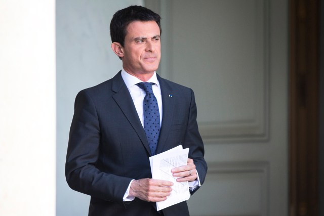French Prime Minister Manuel Valls arrives to deliver a speech at the Elysee Palace in Paris July 31. In April, he placed more than 170 Catholic churches under permanent police protection after an ethnic Algerian and two others were arrested for planning an armed attack on churches at nearby Villejuif. (CNS/EPA)