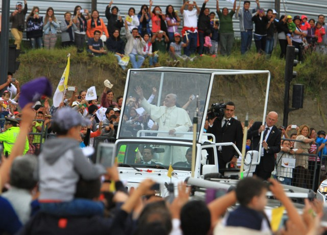 Pope Francis greets the crowd from his popemobile, a Jeep Wrangler, as he arrives in Quito, Ecuador, July 5. The pontiff will use the same model during his visit to the United States in September. (CNS/EPA)