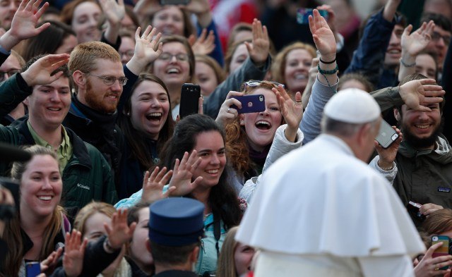 Students from the Austrian program of Franciscan University of Steubenville react as Pope Francis arrives to lead his general audience in St. Peter's Square last March. (CNS/Paul Haring)