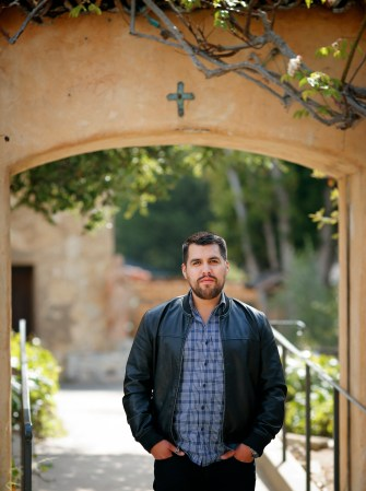 Vincent Medina, a champion of his Ohlone heritage, poses outside the cemetery gate at San Carlos Borromeo de Carmelo Mission in Carmel, Calif. (CNS/Nancy Wiechec)