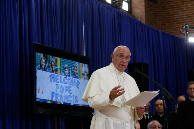 Pope Francis speaks to immigrant families during his visit to Our Lady Queen of Angels Catholic Elementary School in the East Harlem area of New York Sept. 25. (CNS/Paul Haring)