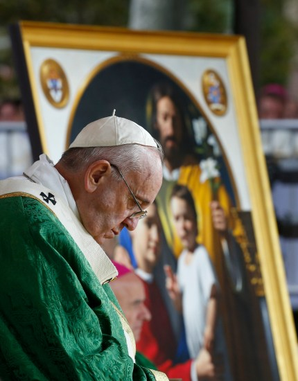 An image of the Holy Family is seen as Pope Francis celebrates the closing Mass of the World Meeting of Families on Benjamin Franklin Parkway in Philadelphia Sept. 27. (CNS photo/Paul Haring)