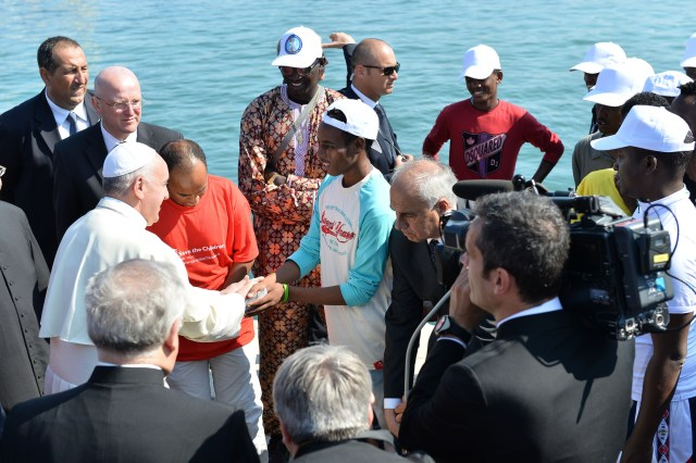 Pope Francis greets immigrants as he arrives at the port in Lampedusa, Italy, in 2013. (CNS/Tullio Puglia, pool)