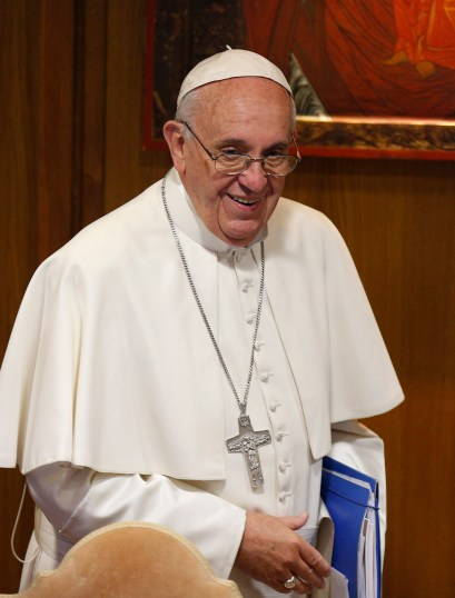 Pope Francis arrives to lead a session of the Synod of Bishops on the family at the Vatican Oct. 9. (CNS/Paul Haring)