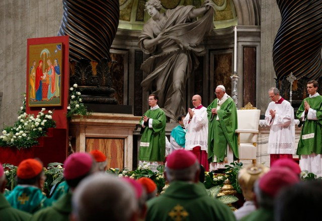 With an image of the Holy Family in the background, Pope Francis celebrates the closing Mass of the Synod of Bishops on the family in St. Peter's Basilica at the Vatican Oct. 25. (CNS/Paul Haring)