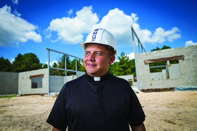 Father Fredy Angel of Ray City, Ga., at St. Anthony of Padua Church's construction site last summer. The Georgia priest won this year's Catholic Extension Lumen Christi Award. (CNS/Rich Kalonick, Catholic Extension)