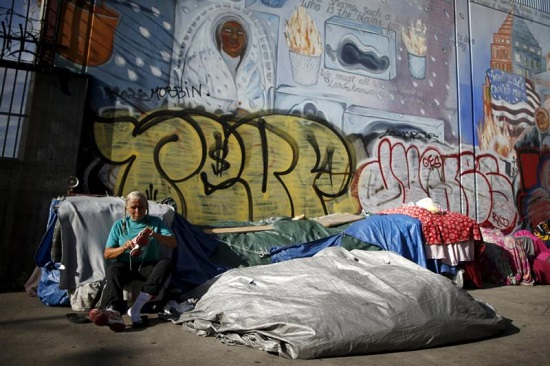 A woman sits outside her tent on Skid Row in downtown Los Angeles Oct. 1. According to World Bank figures issued Oct. 4, 2.2 billion people worldwide live on less than the equivalent of $2 a day. (CNS photo/Lucy Nicholson, Reuters)