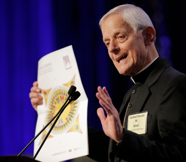 Washington Cardinal Donald W. Wuerl holds a rendering of the design that will decorate the central dome in the upper church of the of the Basilica of the National Shrine of the Immaculate Conception in Washington. (CNS/Bob Roller)