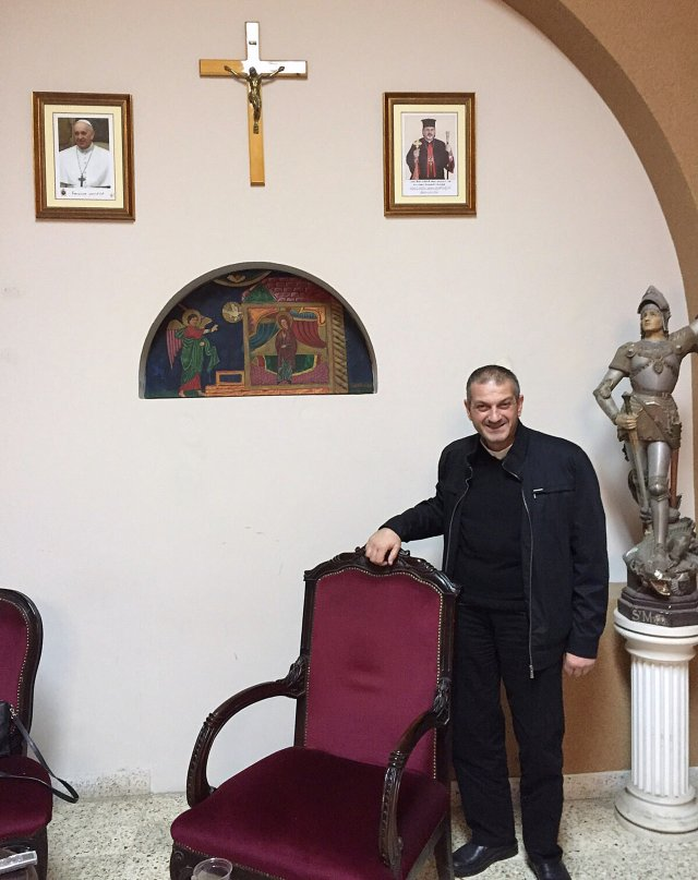 Father Jacques Mourad poses for a photo Nov. 11 in the reception area at Our Lady of the Annunciation Church in Beirut, Lebanon. The Syrian priest escaped Islamic State imprisonment after 84 days. (CNS photo/Doreen Abi Raad)