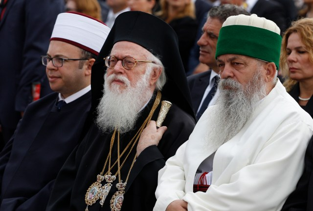 Interreligious leaders look on as Pope Francis celebrates Mass in Mother Teresa Square in Tirana, Albania, in 2014. The pope said he made the one-day trip to Albania to highlight the peaceful collaboration between its Muslim-majority population and minority Catholic and Orthodox communities. (CNS/Paul Haring)