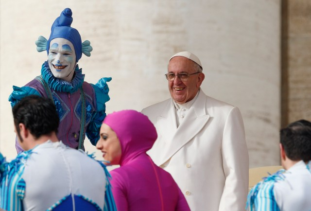Circus members greet Pope Francis after their performance during the pope's general audience in St. Peter's Square at the Vatican Jan. 27. (CNS/Paul Haring)