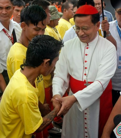 Cardinal Charles Bo of Yangon, Myanmar, is greeted by Filipino inmates at a prison facility in Cebu, Philippines. The famous dancing inmates of the Cebu Provincial Detention and Rehabilitation Center showcased their wares with a Christian-themed dance number performed for the papal legate in the 51st International Eucharistic Congress. (CNS/EPA)