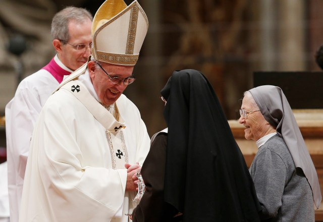 Pope Francis accepts offertory gifts from nuns as he celebrates a Mass with religious in St. Peter's Basilica at the Vatican Feb. 2. The Mass concluded the Year of Consecrated Life. (CNS/Paul Haring)