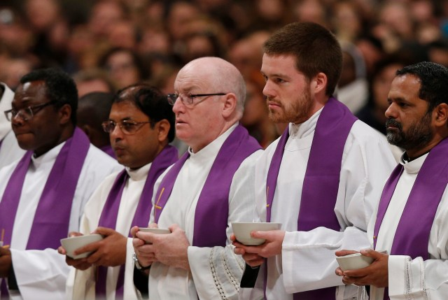 "Priests who are ""missionaries of mercy"" for the Holy Year hold bowls of ashes as Pope Francis celebrates Ash Wednesday Mass in St. Peter's Basilica at the Vatican Feb. 10. (CNS photo/Paul Haring)"