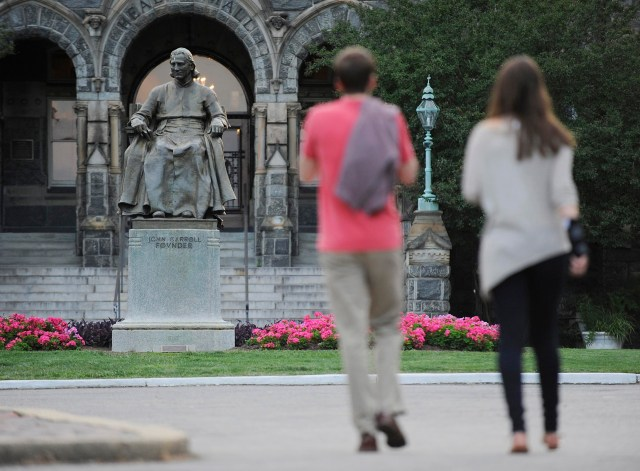 Students on the campus of Georgetown University in Washington pass a statue of Archbishop John Carroll, Baltimore's first archbishop and founder of Georgetown in 2012. (CNS/Reuters)
