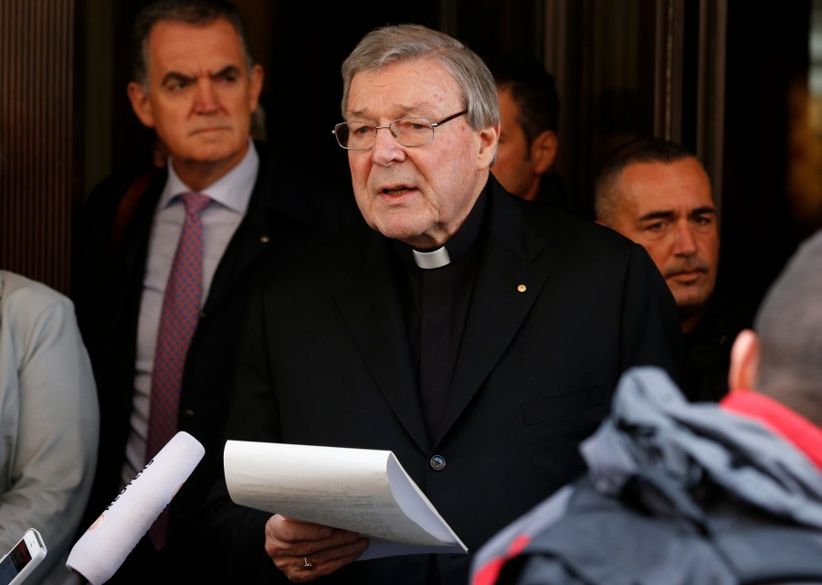 Australian Cardinal George Pell reads a statement to media in front of the Hotel Quirinale in Rome March 3. (CNS/Paul Haring)