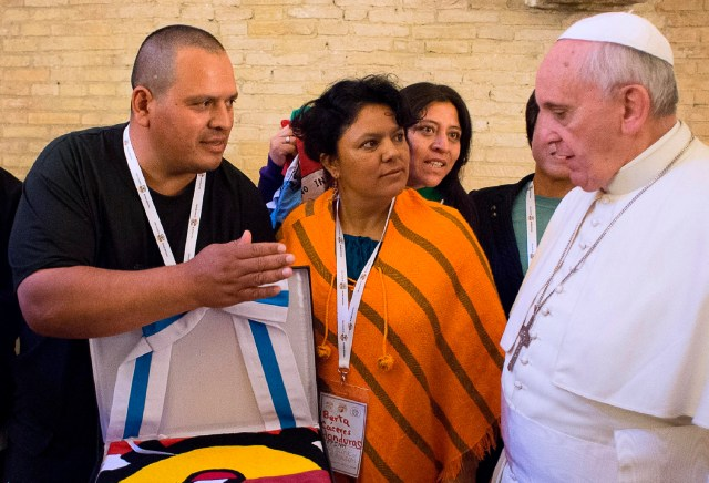 Berta Caceres, center, a Honduran indigenous rights activist and environmentalist, looks toward Pope Francis during the pope's meeting with social activists at the Vatican in this Oct. 28, 2014, file photo. (CNS photo/L'Osservatore Romano)