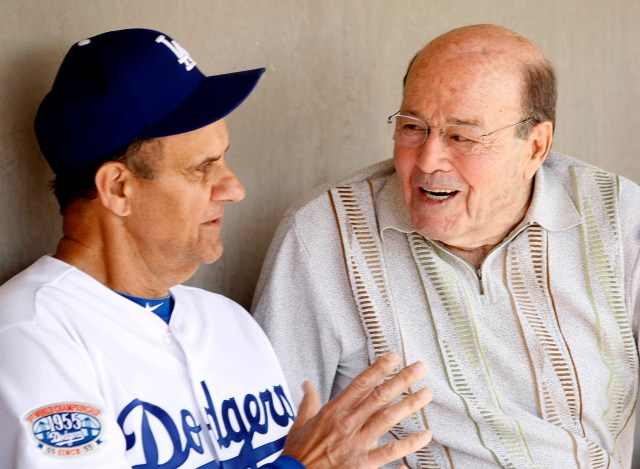 Los Angeles Dodgers head coach Joe Torre talks to Joe Garagiola before playing the Chicago White Sox in a 2010 spring training baseball game in Glendale, Ariz. Garagiola, a legendary broadcaster and former baseball player, died March 23 at age 90 in Scottsdale, Ariz. (CNS photo/Rick Scuteri, Reuters)